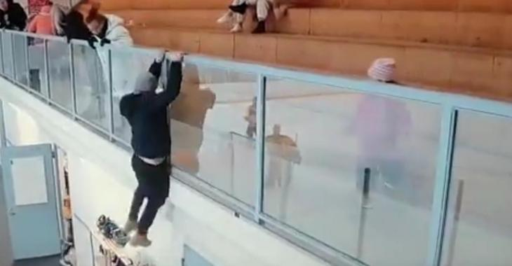 Crazed hockey fan jumps over the glass to attack a player.