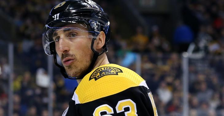 Brad Marchand cross checks Ty Smith in the head.