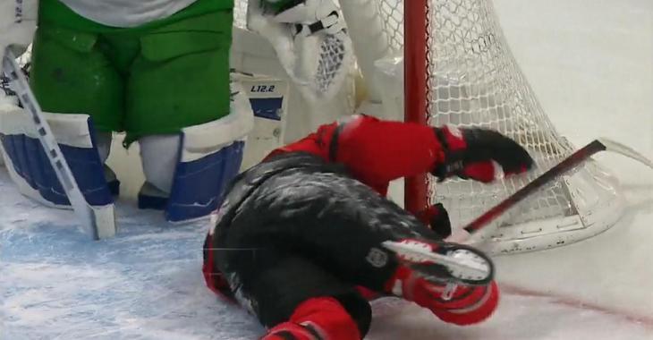 Mitch Marner sends Brady Tkachuk into the goalpost, nearly head first.
