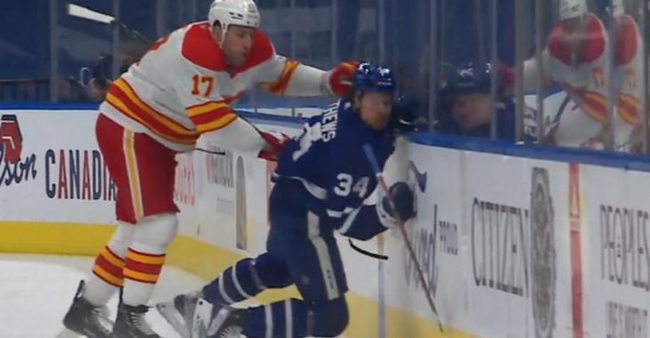 Milan Lucic sends Auston Matthews into the boards with a hit from behind.